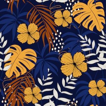 Verano abstracto de patrones sin fisuras con coloridas hojas tropicales y flores en la oscuridad