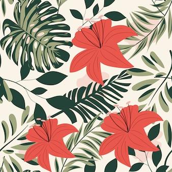 Verano de patrones sin fisuras brillante con coloridas hojas tropicales y plantas sobre fondo pastel