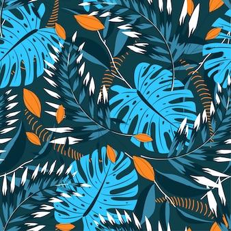 Verano de patrones sin fisuras tropicales con hojas brillantes y plantas sobre un fondo verde