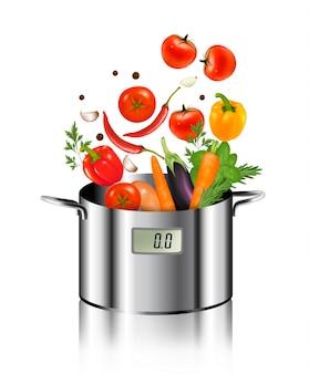 Verduras cayendo en una olla. concepto de comida sana y dietética.