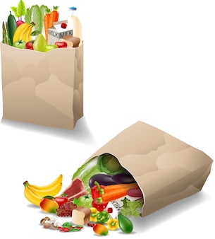 Verduras frescas y frutas en una bolsa de papel