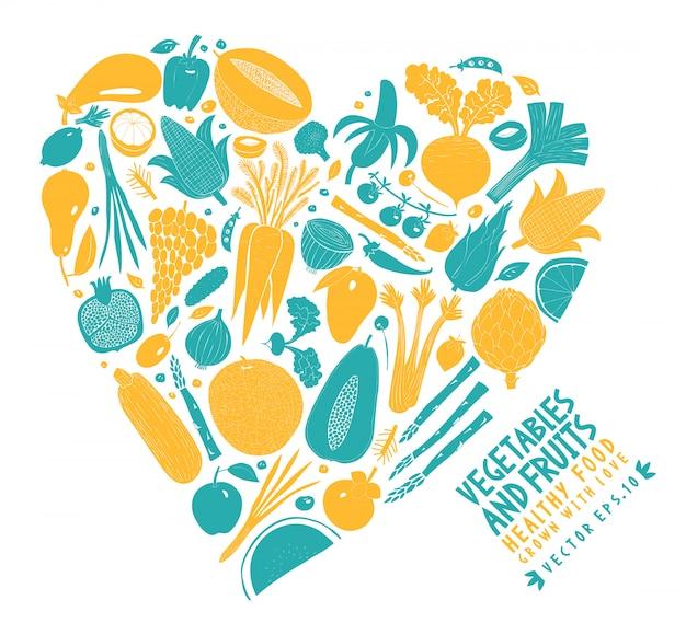 Verduras y frutas dispuestas en forma de corazón.