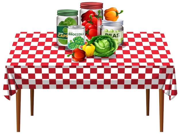 Verduras con vegetales en frascos sobre la mesa con mantel a cuadros
