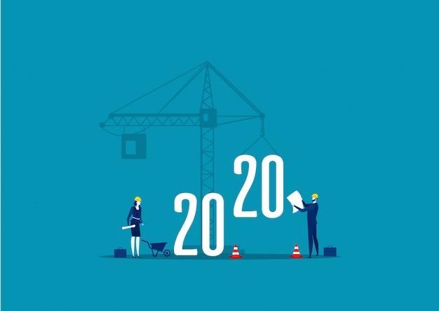 Verificación del ingeniero con grúas de construcción de edificios signo del año 2020