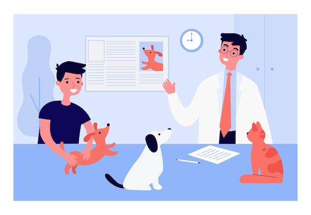 Veterinario dando información al niño sobre mascotas