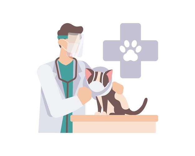 El veterinario usa una mascarilla y un protector facial cuando revisa un lindo gato en la ilustración de la clínica de animales
