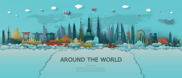 Viajar por el mundo de la arquitectura de monumentos con mapa del mundo y fondo turquesa.