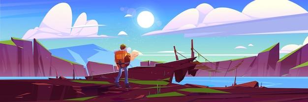 Viajero en el puente colgante sobre el lago de montaña