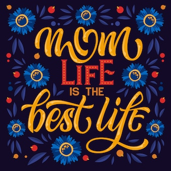 La vida de mamá es la mejor vida: letras temáticas del día de la madre dibujadas a mano. corazón, diseño floral colorido.