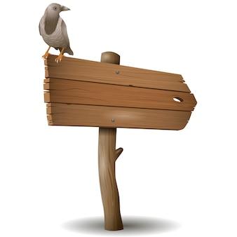 El viejo cartel de madera con un cuervo.