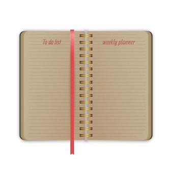 El viejo cuaderno con planificador semanal de marcadores y lista de plantillas de notas