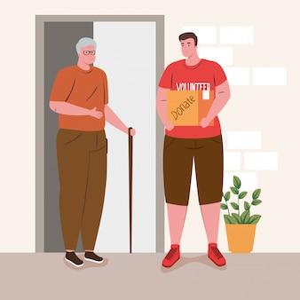Viejo hombre con hombre voluntario con caja de donación, caridad y concepto de donación de asistencia social