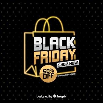 Viernes negro con bolsa de compras sobre fondo oscuro