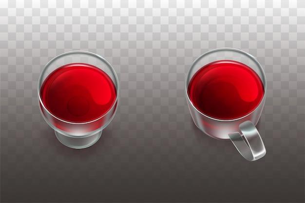 Vino tinto en vaso y té de frutas o jugo de cereza en vaso de vidrio