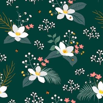 Vintage floral con hojas tropicales de patrones sin fisuras sobre fondo verde oscuro