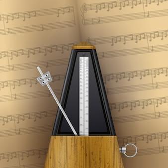 Vintage metrónomo oscilante en la página del cuaderno de música realista