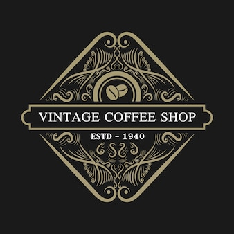 Vintage retro look lujo y estilo occidental antiguo logo dibujado a mano para restaurante de hotel y cafetería