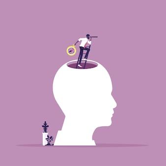 Visión empresarial con la búsqueda de oportunidades en catalejo de pie en la cima de la cabeza humana