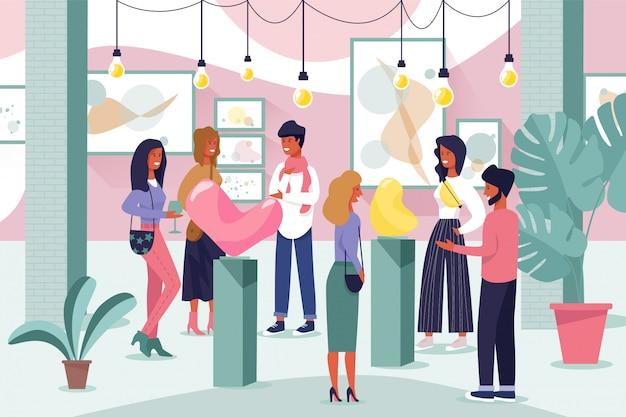 Visitantes de la galería de arte discuten exposición moderna