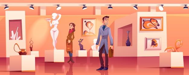 Visitantes en el museo con obras de arte modernas