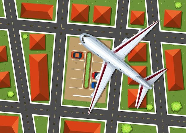 Vista aérea del avión volando sobre el barrio.