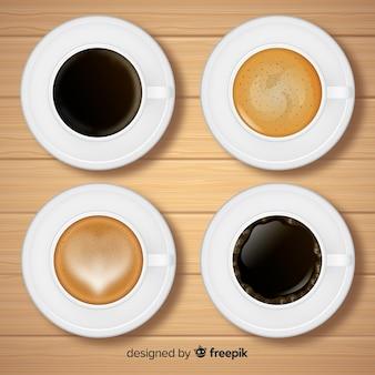 Vista aérea de colección de tazas de café con diseño realista
