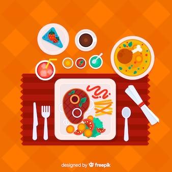 Vista aérea de mesa de restaurante con diseño plano