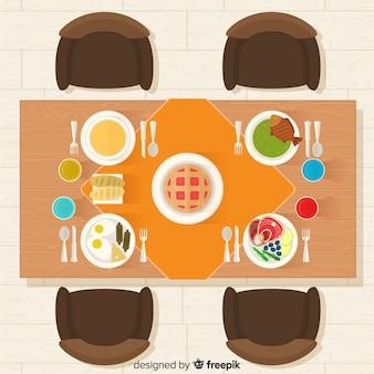 Vista aérea de mesa de restaurante elegante con diseño plano