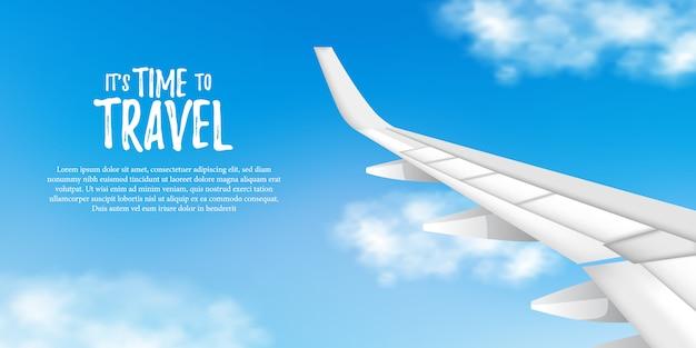 Vista desde el avión con cielo azul y alas de avión.