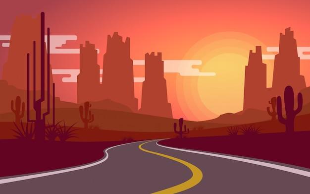 Vista del desierto mientras el sol se pone con un camino rural vacío.