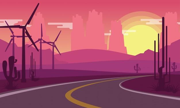 Vista del desierto mientras el sol se pone con molino de energía eólica