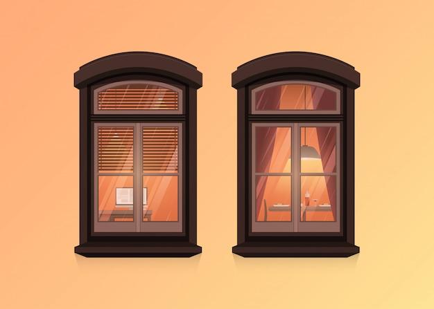 Vista de dos marcos de ventanas en la pared de la casa