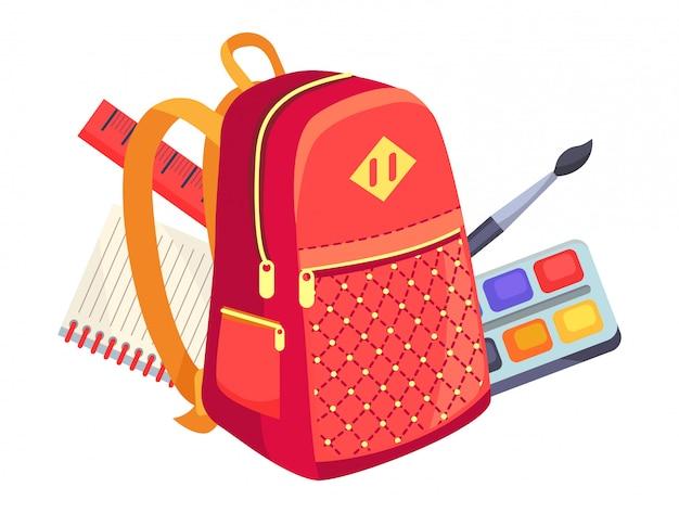Vista lateral de la mochila infantil y pinturas con pincel