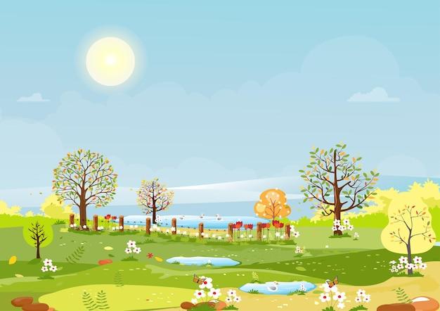 Vista panorámica de la aldea de primavera con prado verde en las colinas