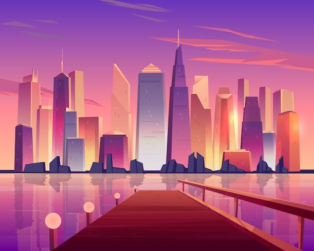 Vista panorámica del horizonte de la ciudad desde el muelle de madera frente al mar iluminado por lámparas y rascacielos futuristas