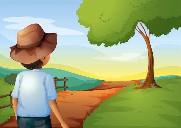 Una vista posterior de un joven agricultor