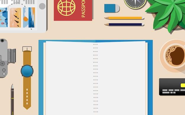 Vista superior de abajo de la mesa de trabajo con espacio de copia en el cuaderno vacío