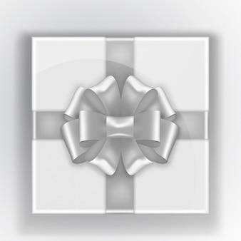 Vista superior de la caja de regalo. la cinta gris en la caja.