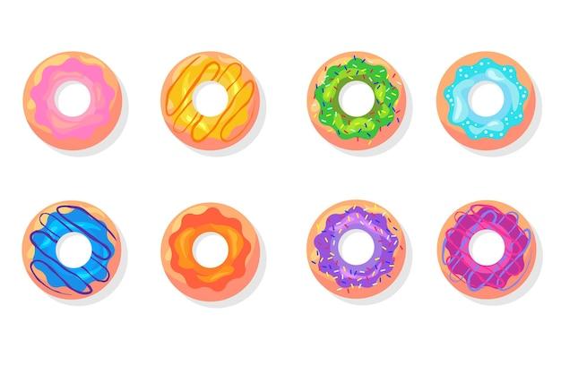 Vista superior del conjunto de elementos planos coloridos donuts.