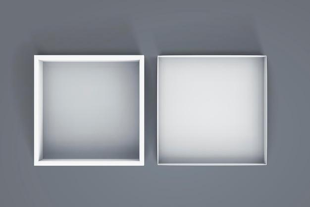 Vista superior del cuadro blanco abierto en blanco sobre fondo gris azul en la ilustración 3d