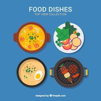 Vista superior de platos de comida con diseño plano