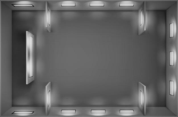 Vista superior de la galería vacía con marcos de fotos en blanco iluminados