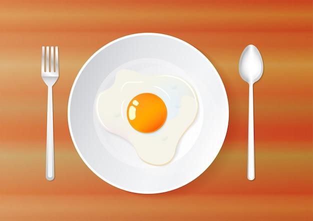 Vista superior de huevos fritos en placa