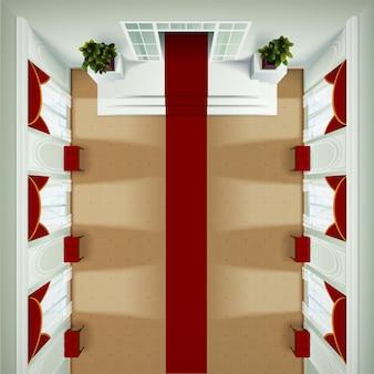 Vista superior del interior del vestíbulo del club de teatro o hotel con banqueta roja