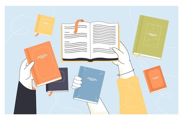 Vista superior de manos sosteniendo libros abiertos y cerrados