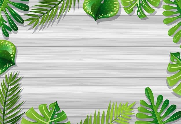 Vista superior de la mesa de madera en blanco con elementos de hojas