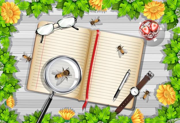 Vista superior de la mesa de madera con objetos de oficina y elementos de hojas e insectos