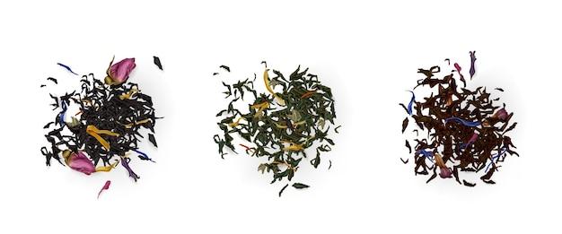 Vista superior de montones de té, variedad de hojas secas y flores aisladas en blanco