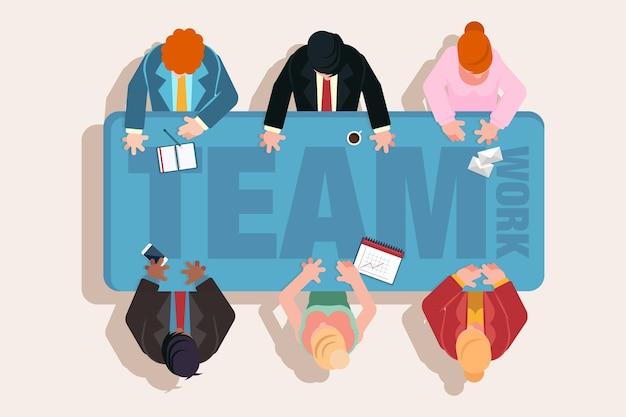 Vista superior de personas de trabajo en equipo en una reunión