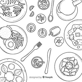 Vista superior de platos en mesa de restaurante